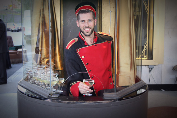 Guests were greeted with champagne served through the ticket booth window.