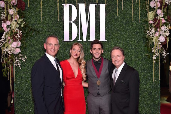 Pictured (L-R): President and CEO of BMI Michael O'Neill, Lauren Gregory, singer-songwriter Thomas Rhett, Vice President of Writer-Publisher Relations Jody Williams. Photo: John Shearer/Getty Images for BMI