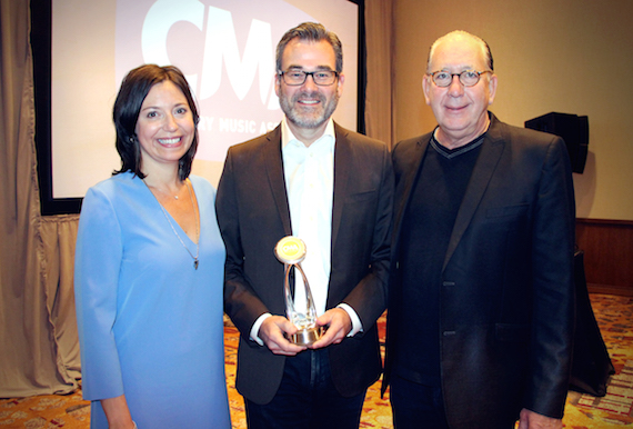 CMA Board President Sally Williams, Irving Waugh Award of Excellence recipient Steve Buchanan and CMA Board Chairman John Esposito. Photo: Christian Bottorff / CMA