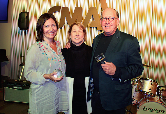 CMA Chief Executive Officer Sarah Trahern (center) presents incoming 2017 CMA Chairman Sally Williams and outgoing CMA Chairman John Esposito with the crystal globe and gavel during a Board dinner Monday at CMA's new Music Row headquarters. Photo: Christian Bottorff / CMA