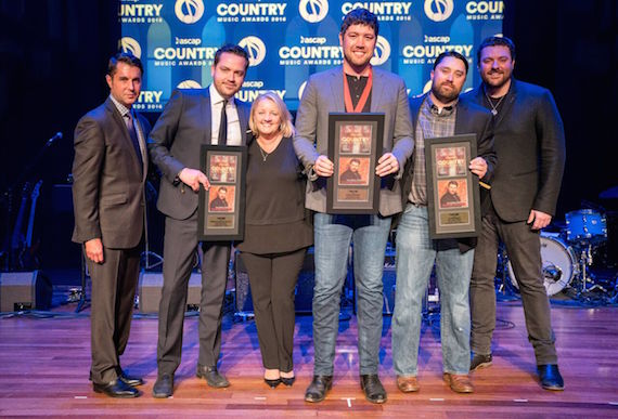 """ASCAP VP of Membership Michael Martin (l) congratulates (L-R) Warner Chappell's Travis Carter, Liz Rose Music's Liz Rose, songwriter Corey Crowder, Liz Rose Music's Scott Ponce, and RCA Records Nashville recording artist Chris Young on their ASCAP Top Five Song, """"I'm Comin' Over."""" Photo: Ed Rode"""