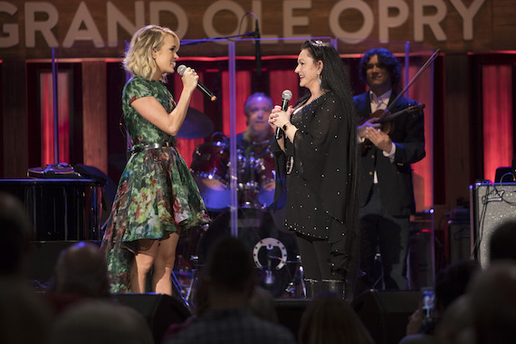 Carrie Underwood invites Crystal Gayle to join the Grand Ole Opry. Photo: Chris Hollo/Grand Ole Opry