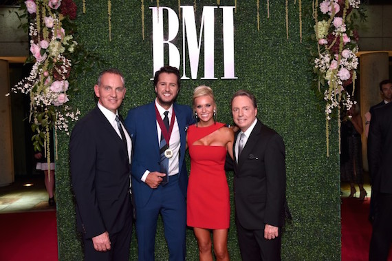 Pictured (L-R): President and CEO of BMI Michael O'Neill, singer-songwriter Luke Bryan, Caroline Boyer, and Vice President, Writer/Publisher Relations at BMI Jody Williams. Photo: John Shearer/Getty Images for BMI