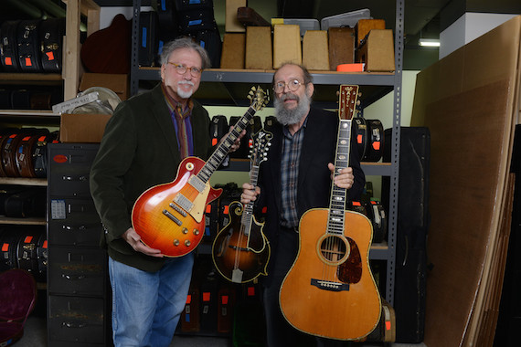 "Doug Howard hold a 1923 Gibson F-5 Lloyd Loar mandolin, 1960 Les Paul Standard ""Burst"" electric guitar and 1939 Martin D-45 acoustic guitar that have been donated to Belmont University at Gruhn Guitars in Nashville, Tenn. November 8, 2016."