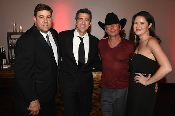 (L-R:) Sony Music Nashville's VP of A&R Jim Catino and EVP & COO Ken Robold, CMA Pinnacle Award winner Kenny Chesney, and Sr. Director of A&R Taylor Lindsay. Photo credit: Erika Goldring