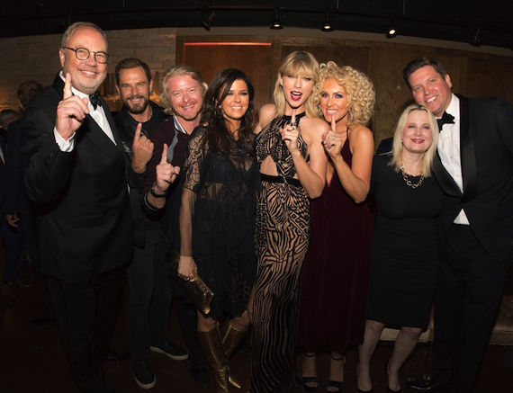 "Songwriter Taylor Swift and Little Big Town celebrate ""Better Man"" topping the iTunes all-genre chart following the band's performance of the hit at last night's 50th Annual CMA Awards. L to R: UMGN Chairman and CEO Mike Dungan; LBT's Jimi Westbrook; LBT's Phillip Sweet; LBT's Karen Fairchild; Taylor Swift; LBT's Kimberly Schlapman; UMGN President Cindy Mabe; Sandbox Entertainment's Jason Owen"