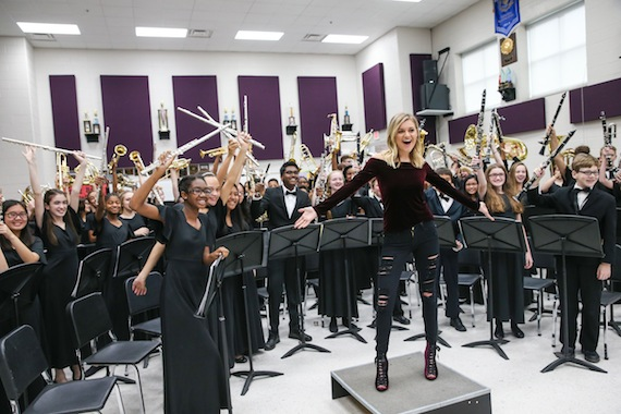 NASHVILLE, TN - DECEMBER 06: Singer-songwriter Kelsea Ballerini speaks to the Oliver Middle School wind Ensemble during the CMA Foundation's Announcement of a $1 million donation to the Metro Nashville public schools 'Music makes us' progam at Oliver Middle School on December 6, 2016 in Nashville, Tennessee. (Photo by Terry Wyatt/Getty Images)