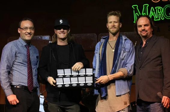 Florida Georgia Line accepts MusicRow No. 1 Challenge Coins for five chart-toppers on the CountryBreakout chart. Pictured (L-R): Craig Shelburne; Florida Georgia Line's Tyler Hubbard and Brian Kelley; MusicRow's Owner/Publisher Sherod Robertson.